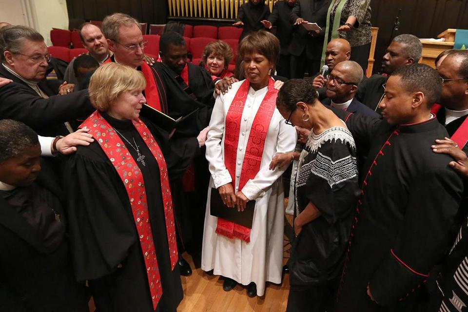 Clergy members laid hands on the Rev. Liz Walker on Sunday during her installation as pastor of Roxbury Presbyterian Church.
