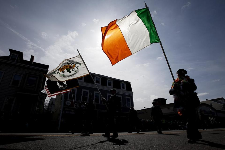 A parade participant carried an Irish flag at the St. Patrick's Day Parade in South Boston last year.