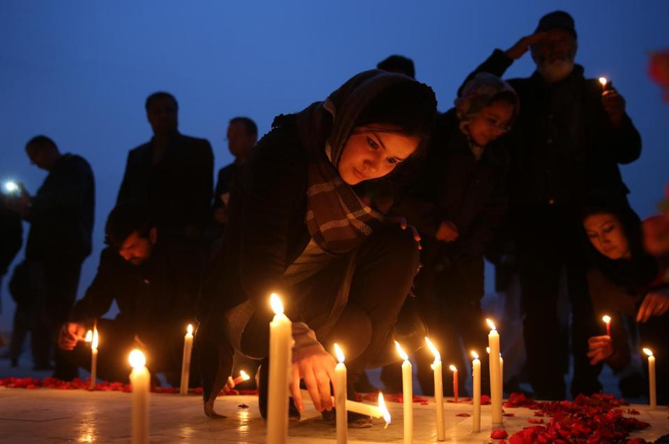 Afghans lit candles for 21 soldiers killed in a Taliban attack on an army base last month.
