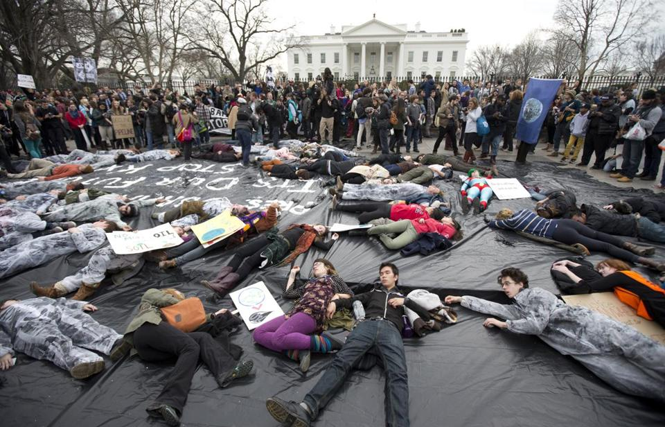 Demonstrators lay down in front of the White House during a protest against the proposed Keystone XL oil pipeline. (AP Photo/Manuel Balce Ceneta)