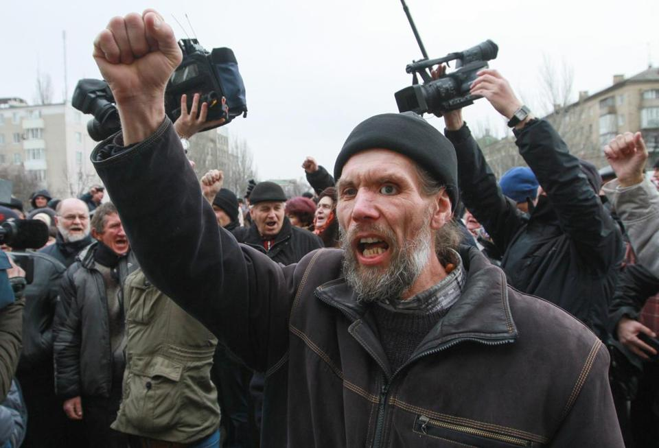 Pro-Russian protesters shouted slogans after they left the Regional administration building in Donetsk, Ukraine.