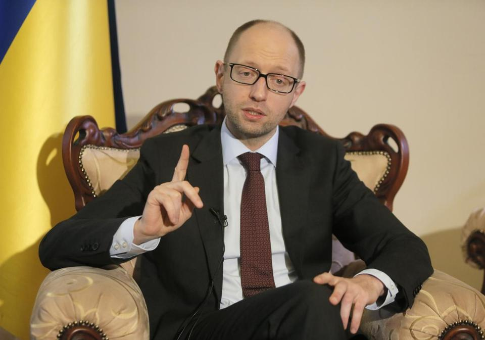 Arseniy Yatsenyuk, Ukraine's new prime minister, said that embattled Crimea must remain part of Ukraine, but may be granted more local powers.