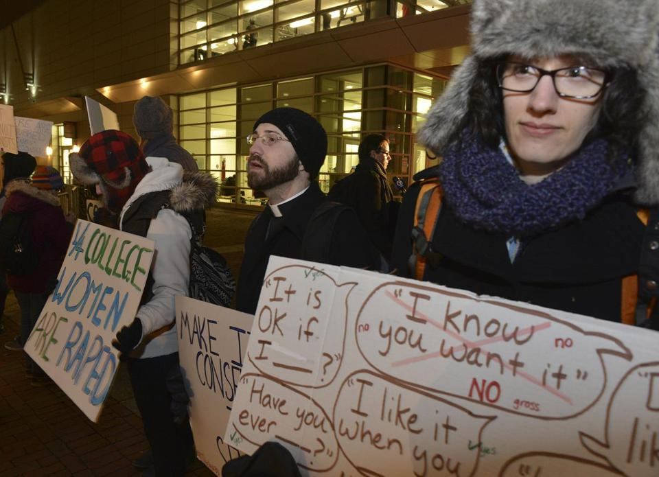 Derek Knox (center) and Alison Landry protesting the concert by Robin Thicke outside Boston University's Agganis Arena.