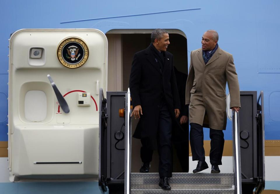 President Obama was joined by Governor Deval Patrick as he stepped off Air Force One at Logan Airport Wednesday.