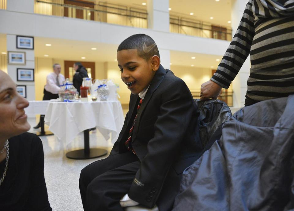 James, 8, talked to Jacquelyn Lamont, a forensic interviewer in the Suffolk district attorney's office and director of youth safety and outreach, during the exhibit's opening Tuesday night at the Edward W. Brooke Courthouse.  Five children received framed copies of their photographs with their words of encouragement.