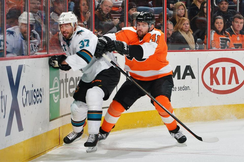 Andrej Meszaros (above, right) could be out of Philadelphia's picture because of Andrew MacDonald's acquisition.