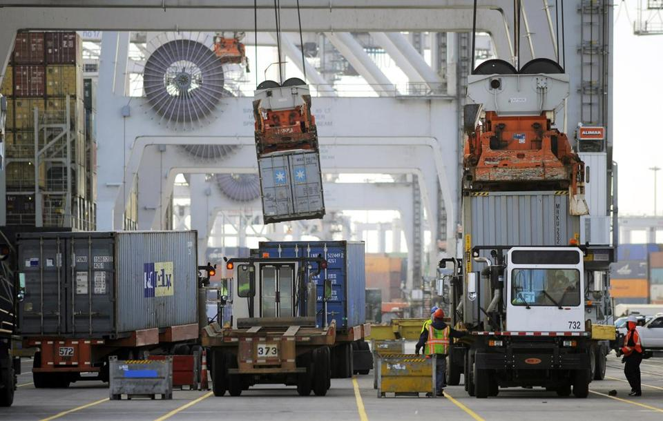 Shipping containers are loaded and unloaded at a terminal in Savannah, Ga. While factory orders dipped slightly in January, analysts see signs of growing business confidence.