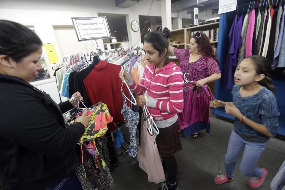 Used clothes at Sacred Heart Community Service in San Jose, Calif. Low-wage workers struggle in the high-priced area.