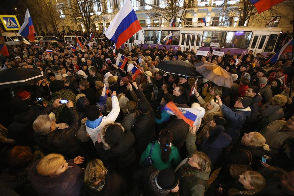 People waving Russian flags gathered to hear the announcement confirming that the Sevastopol regional council supported the vote for Crimea to secede from Ukraine and join Russia.