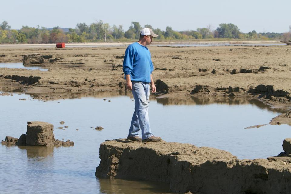 Rob Chatt surveyed damage from the Missouri River flooding in Tekamah, Neb., Sept. 19, 2011.