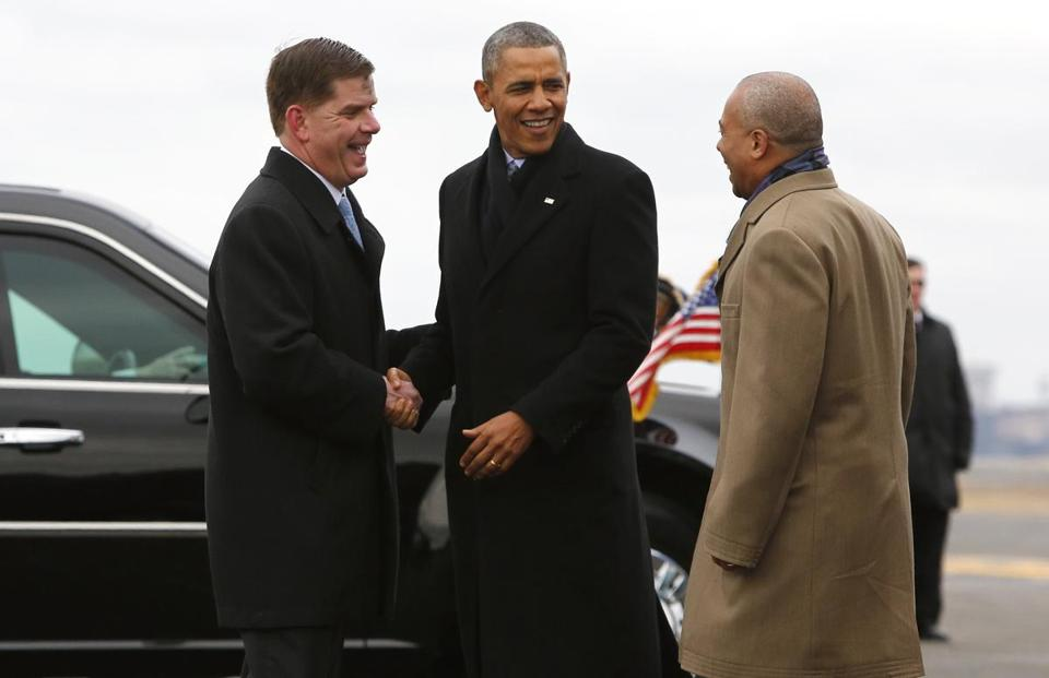 Boston Mayor Martin J. Walsh greeted President Barack Obama and Massachusetts Governor Deval Patrick as they arrived aboard Air Force One at Logan International Airport in Boston Wednesday, March 5, 2014.
