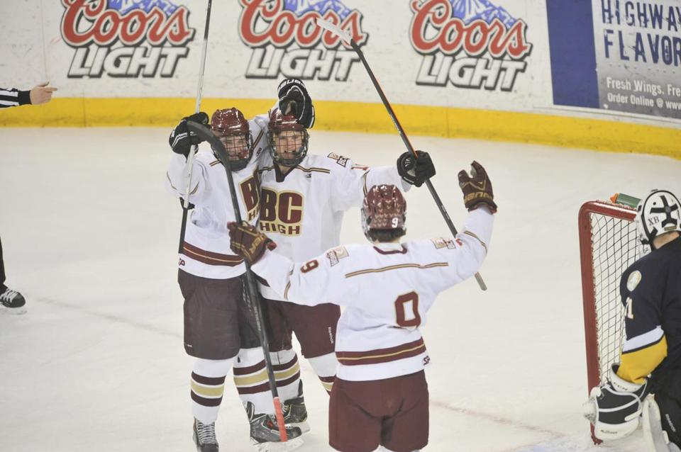 Connor Noonan (9) celebrates with his teammates after a BC High tally.