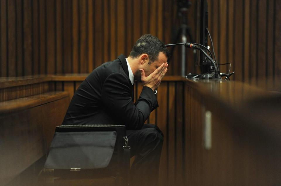 Oscar Pistorius covered his face during his trial on Thursday.