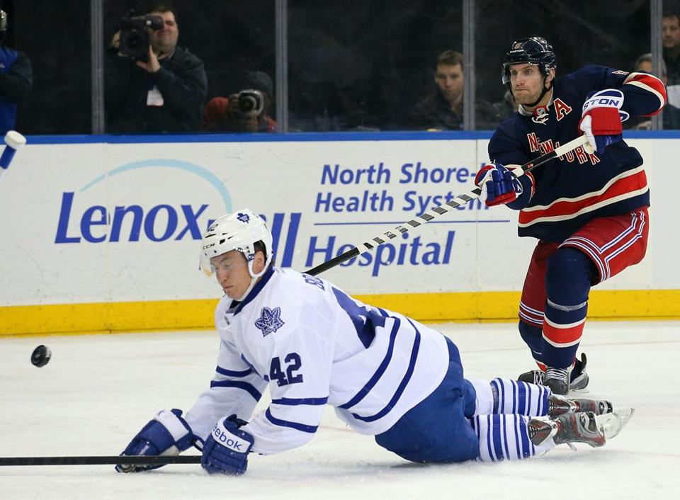 Rangers defenseman Dan Girardi (5) had his shot blocked by Maple Leafs center Tyler Bozak during the second period.