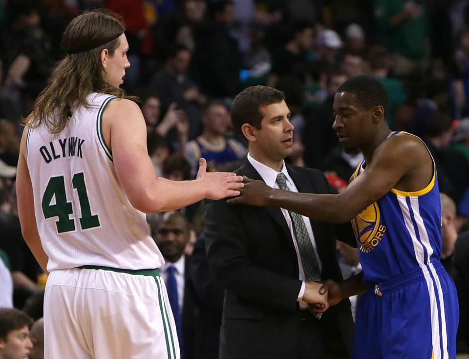 Former Celtic Jordan Crawford (right) caught up with Kelly Olynyk (left) and Celtics coach Brad Stevens after the game.