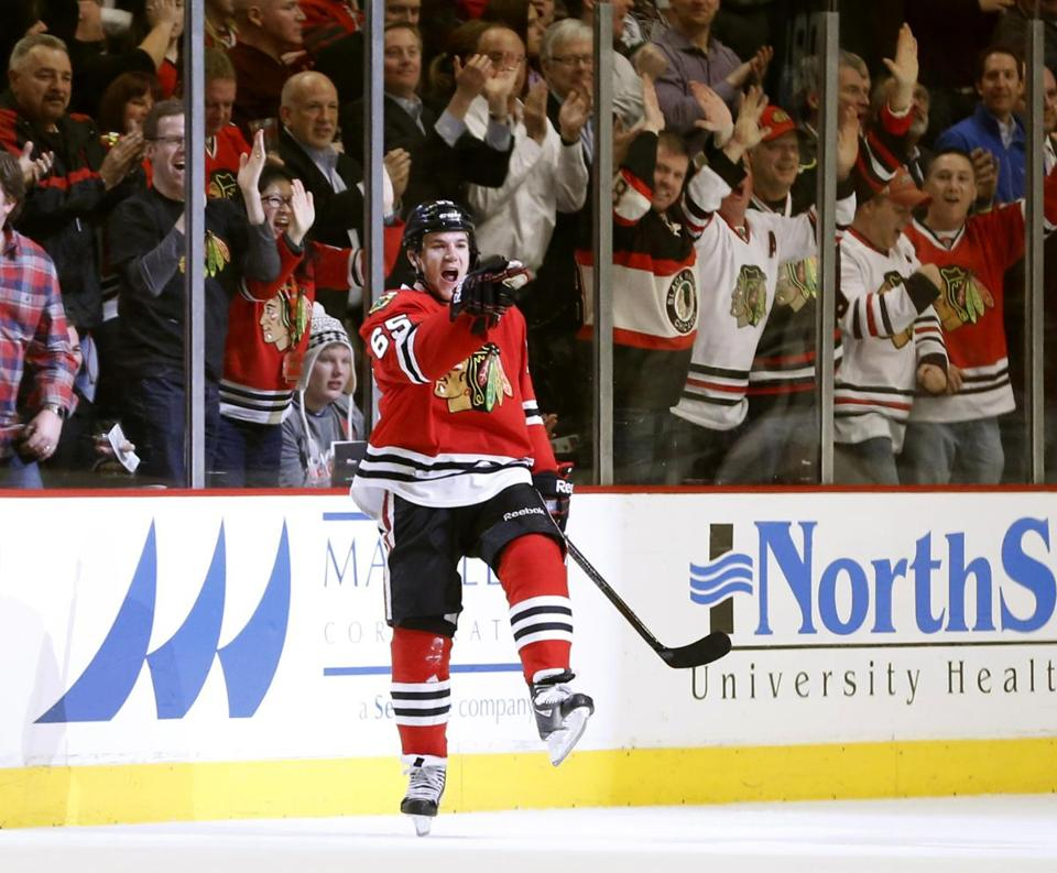 Blackhawks center Andrew Shaw celebrated one of his goals during the first period Thursday.