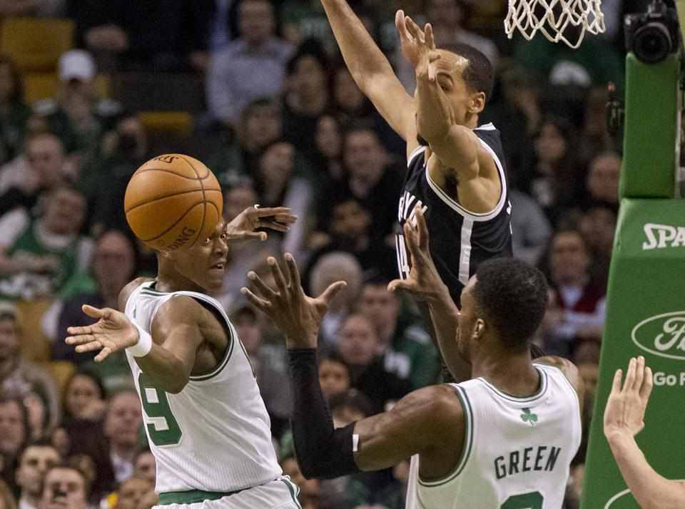 Celtics guard Rajon Rondo threw a pass to Jeff Green, as the Nets' Shaun Livingston provided pressure.