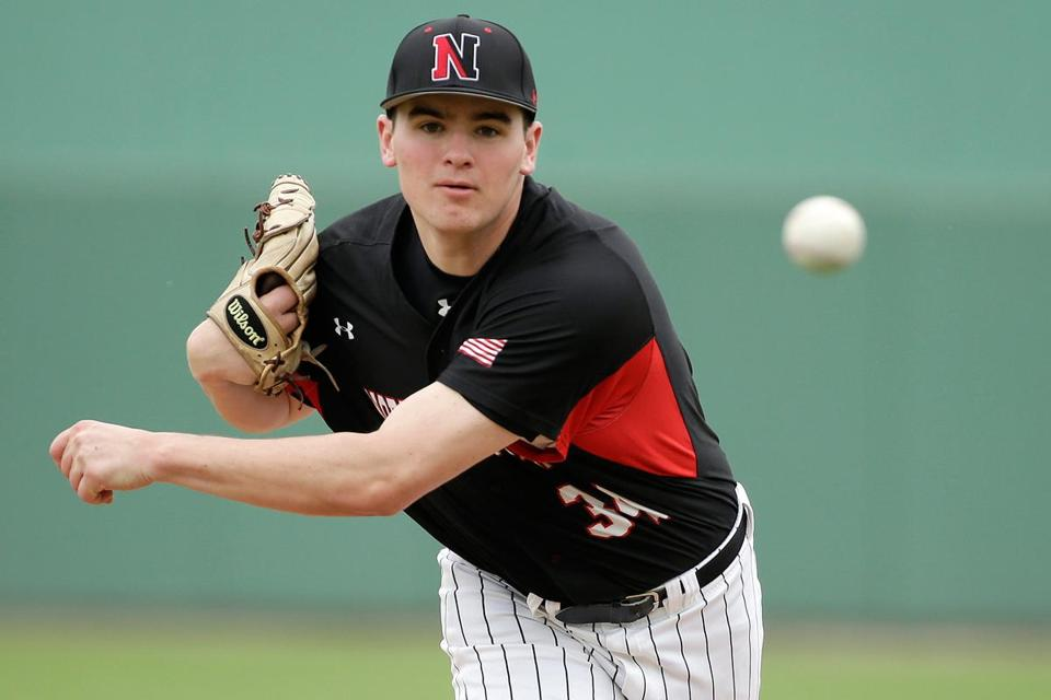 Northeastern's James Mulry throws a warm-up pitch before facing the Red Sox in their spring game.