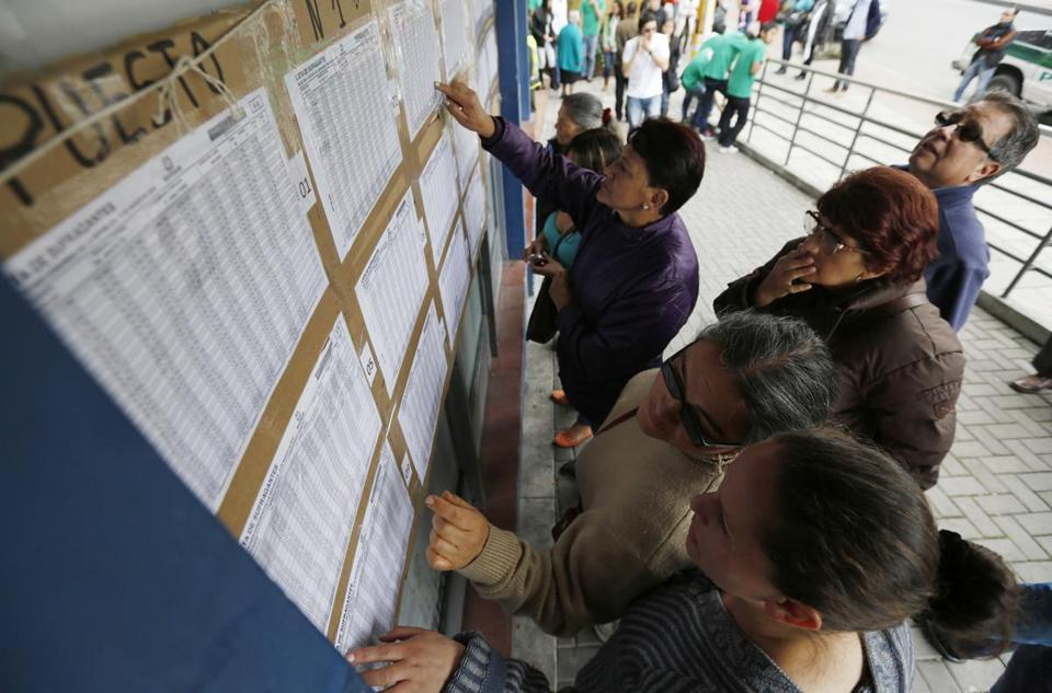 Voters checked a list to confirm where they should cast their ballots for legislative elections in Bogota Sunday.
