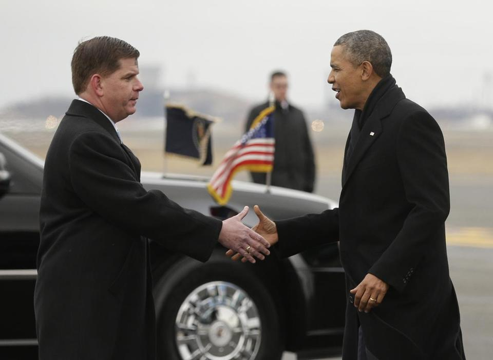 Boston Mayor Martin Walsh greeted President Obama on the tarmac at Logan Airport when Obama visited the city to attend Democratic fund-raisers.