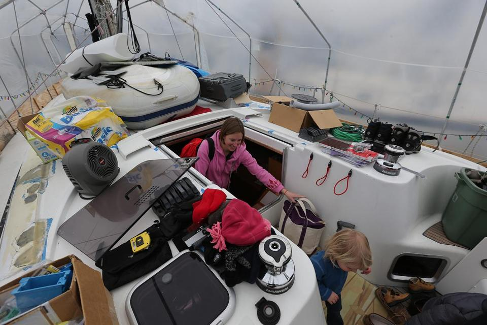 Sarah Garant and her family live year-round on their sailboat, which is covered in plastic during the cold months