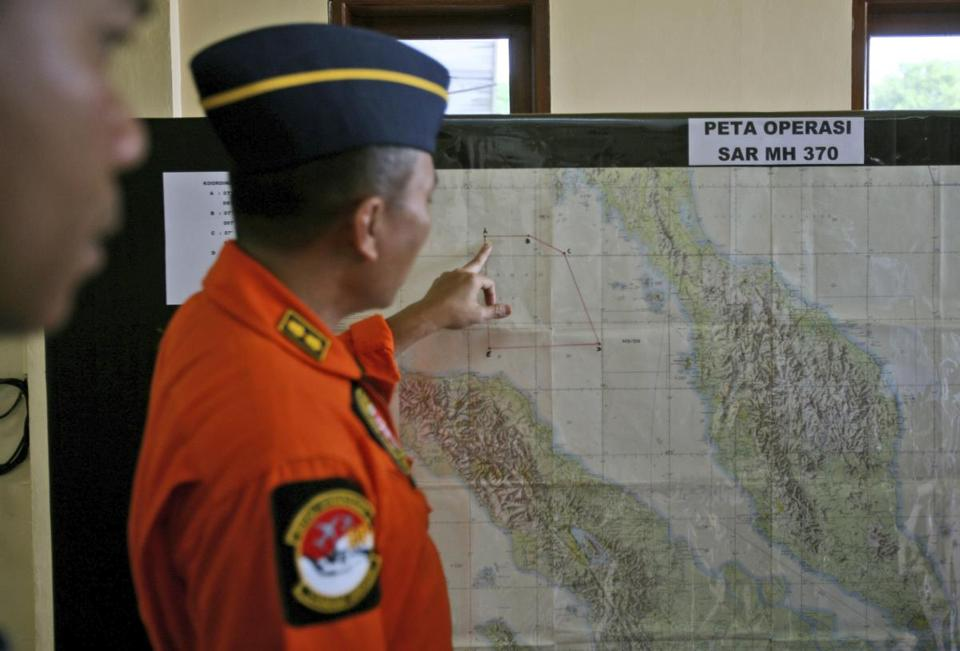 An Indonesia air force officer looked at a map of the Malacca Strait during a briefing prior to a search operation for the missing Malaysia Airlines Boeing 777.