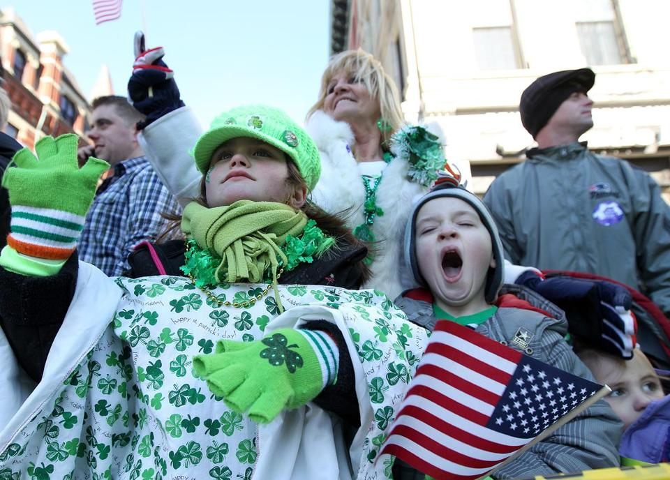 Cousins Aniela Michalik of Tyngsboro, left, and James Toland of Weymouth watched last year's St. Patrick's Day parade with their grandmother Annmarie Ferreira of Billerica.