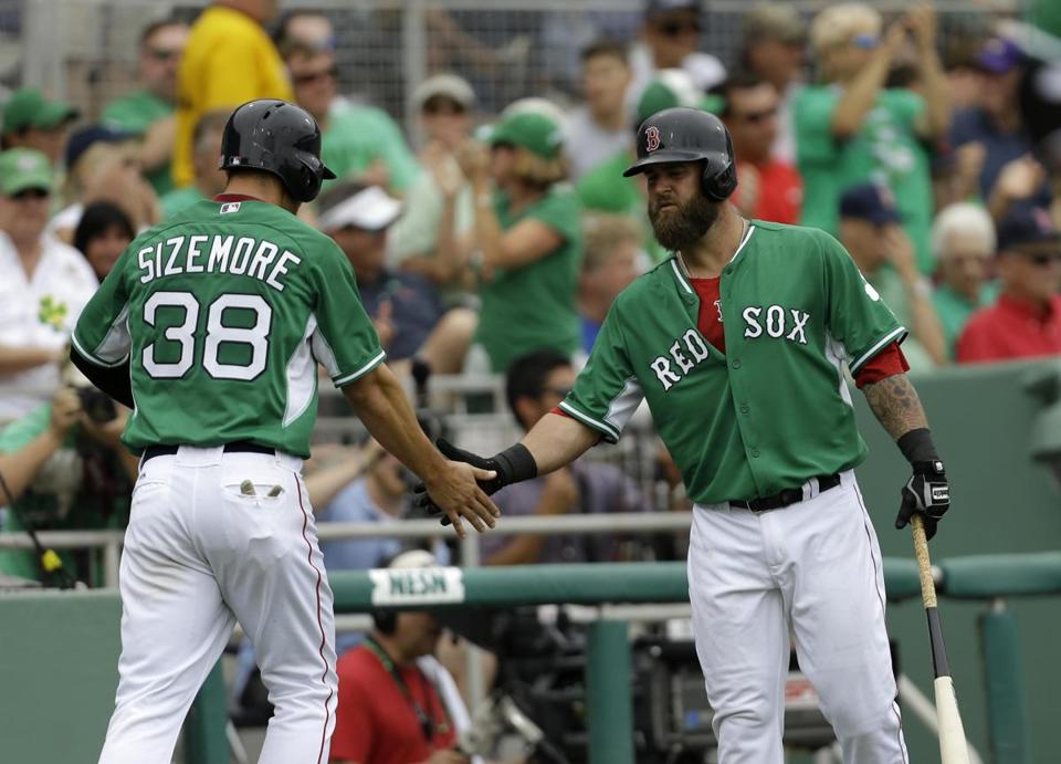 Boston Red Sox Grady Sizemore (38) is greeted by Mike Napoli on an RBI double by Dustin Pedroiain the fifth inning of an exhibition baseball game against the St. Louis Cardinals in Fort Myers, Fla., Monday, March 17, 2014. The Red Sox won 10-5. (AP Photo/Gerald Herbert)