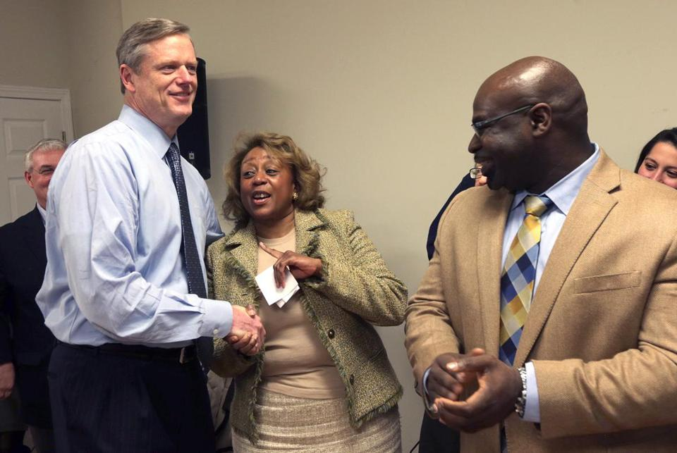 Rachel Kemp, with Charlie Baker at a preconvention rally in Hyde Park, has been reaching out to communities of color.