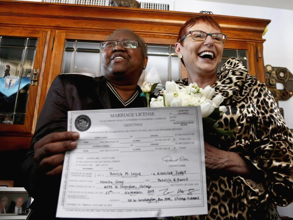 Vernita Gray (left) and Patricia Ewert were happy to show their marriage license in their Chicago home in November.