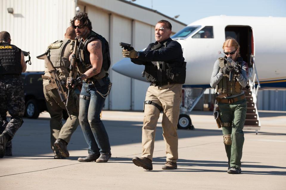 "Arnold Schwarzenegger (center, with Joe Manganiello and Mireille Enos) leads an undercover DEA team in ""Sabotage."""