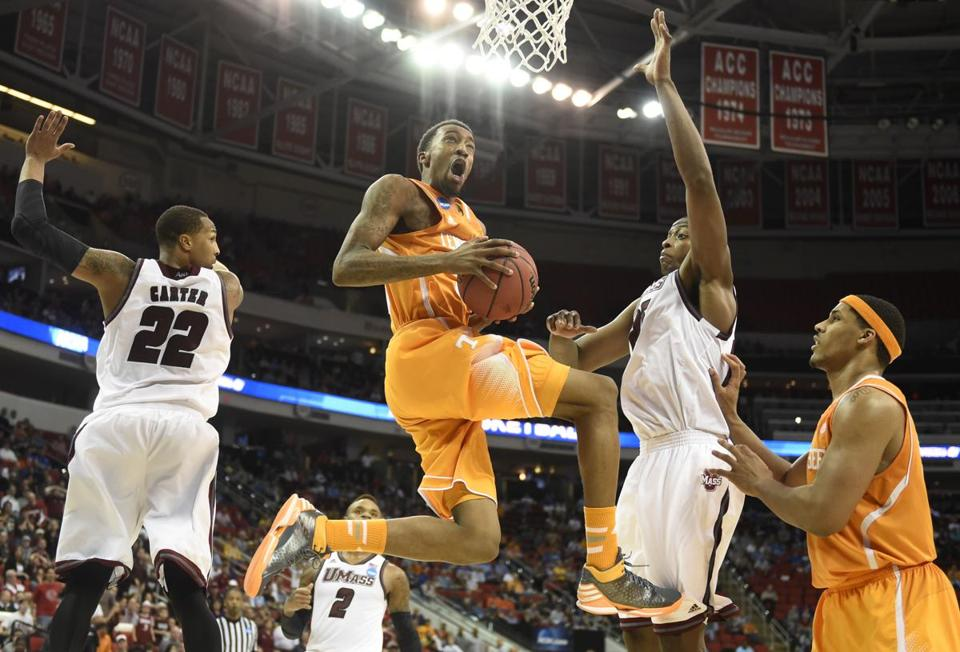 Tennessee's Jordan McRae finds air and space between Sampson Carter and Cady Lalanne.
