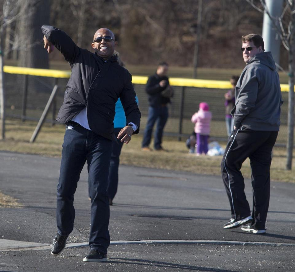 Mariano Rivera plays pinky ball with kids in the parking lot at City Park before his son pitches for Iona College.