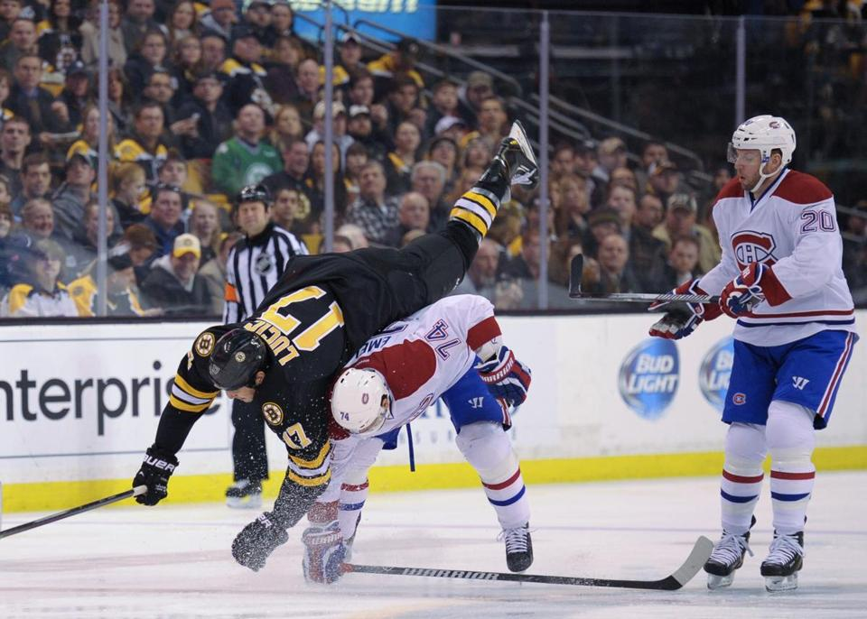 Montreal Canadiens defenseman Alexei Emelin put a hit on Milan Lucic during the first period.