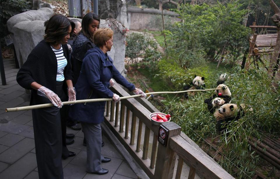 Michelle Obama and her mother, Marian Robinson, visited the Giant Panda Research Base in China, where they fed the animals apples.  The tour ended Wednesday.