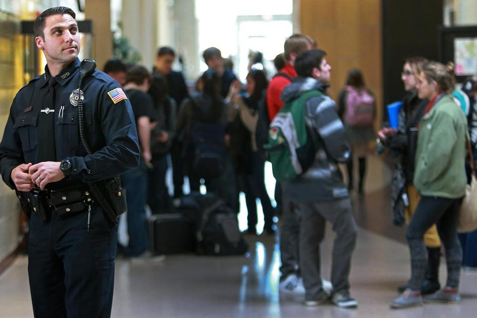 """My goal,'' says Officer Corey Santasky, pictured mingling with students between classes at Reading High School, ""is to make sure they can trust me, that I'm a resource for them."""