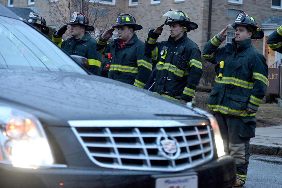 Firemen saluted as the body of Lieutenant Edward J. Walsh Jr. was brought to a Watertown funeral home.