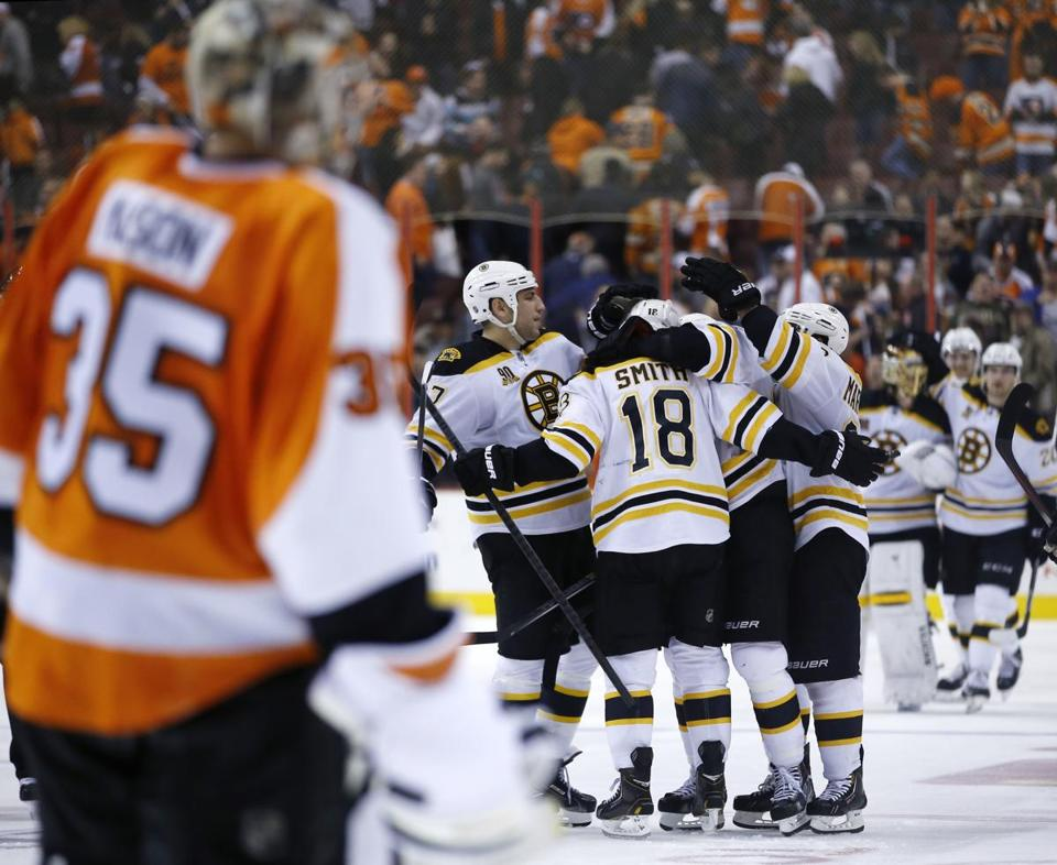 Reilly Smith celebrates with teammates after scoring the game-winning goal in the shootout.