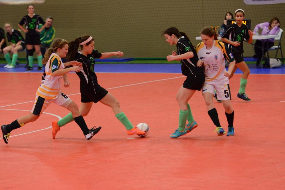 Insa Mannstadt stretches to make a pass while playing futsal for the Dream Team club of Arlington.