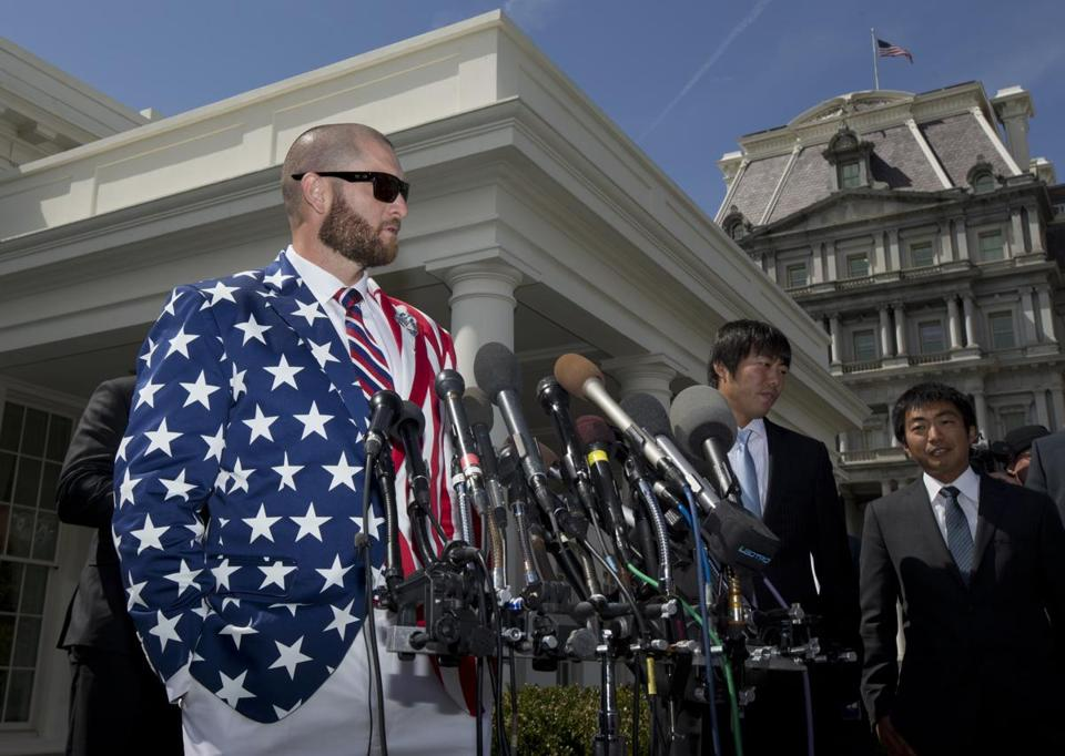 Boston Red Sox outfielder Jonny Gomes (left) spoke to reporters April 1 in front of the West Wing of the White House in Washington, D.C., following a ceremony where President Barack Obama honored the 2013 World Series baseball champion the Boston Red Sox on the White House South Lawn.