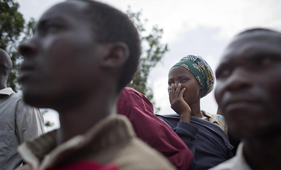 A woman gestured as she listened to genocide memories and observed a flame of remembrance at a March 27 ceremony in the town of Kirehe in eastern Rwanda.