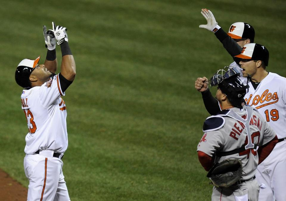 Nelson Cruz (left), who usually raises his game against the Red Sox, belted a two-run home run in the fourth inning Baltimore. (AP Photo/Nick Wass)