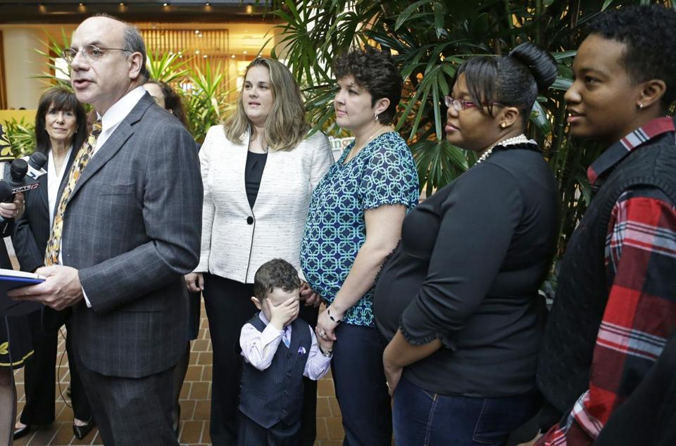 Attorney Al Gerhardstein, left, stood with several same-sex couples at a news conference Friday.
