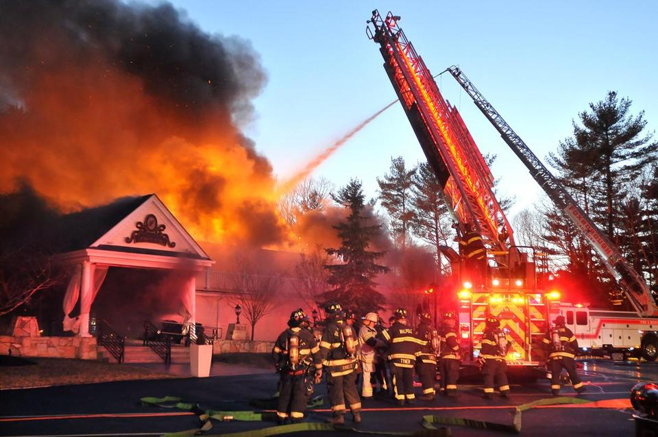 Firefighters responded to a three alarm fire at the Lakeview Pavilion in Foxborough Saturday, April 5, 2014. A wedding was taking place at the time of the fire.