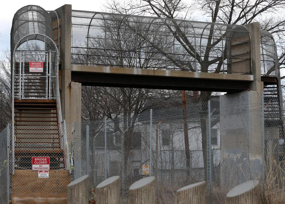 The MBTA has fenced off the pedestrian bridge between Ceylon and Bird streets, provoking the ire of Roxbury residents.