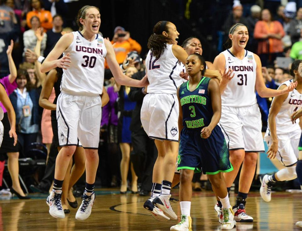 Stars Breanna Stewart (30) and Stefanie Dolson (31) celebrated after Connecticut beat Notre Dame, 79-58, on Tuesday for the women's NCAA basketball crown. Their male counterparts defeated Kentucky in the finals the night before. The wins were a repeat of 2004, when UConn became the only school to win both titles.