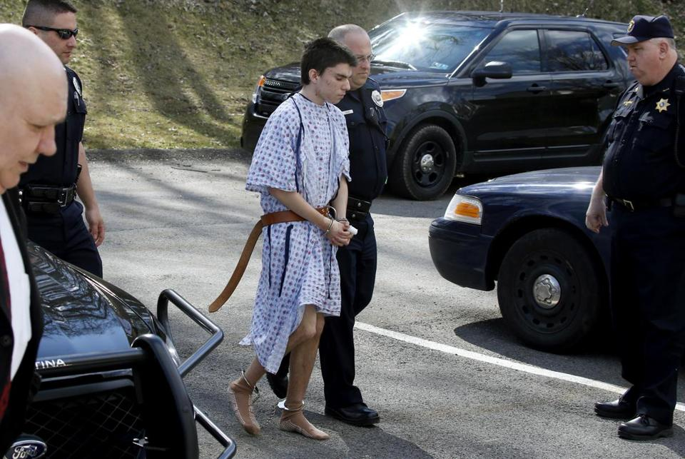 Alex Hribal was escorted by police to be arraigned in Export, Pa.