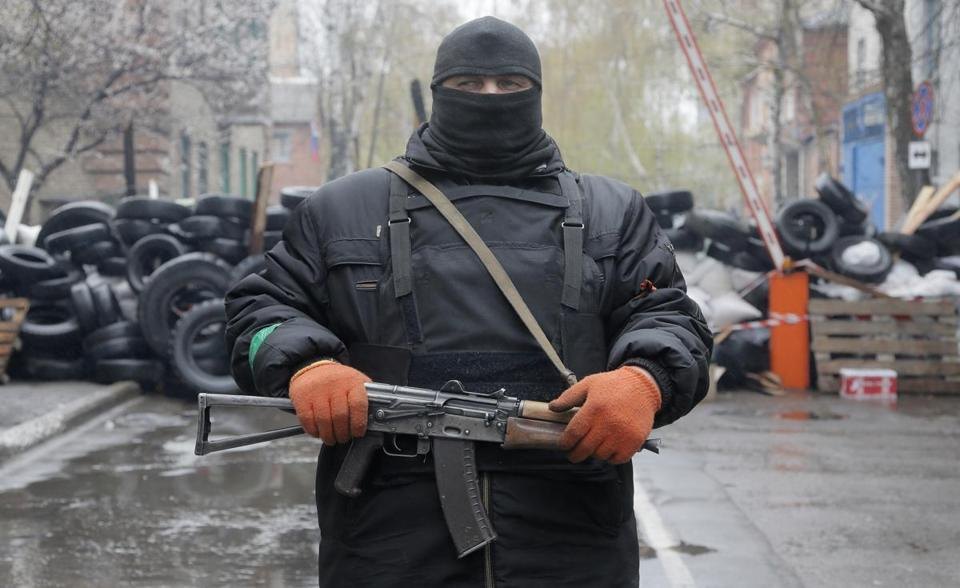 A pro-Russia gunman guarded a seized police station in the eastern Ukraine town of Slovyansk on Sunday.