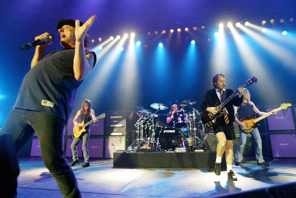 Malcolm Young, second from left, performed with AC/DC in Munich in 2003. Also on stage were Brian Johnson, Phil Rudd, Angus Young, and Cliff Williams.