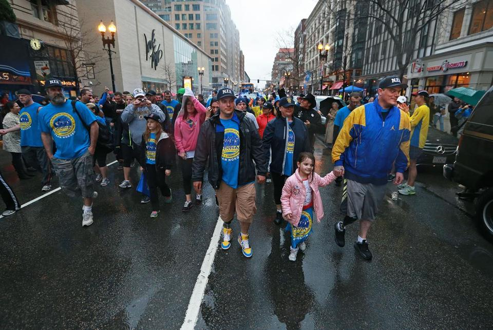 Brothers J.P. Norden (front, left) and Paul Norden (at right, holding the hand of his niece Gabbie) walked toward the Marathon finish line along with a large group of family and friends.